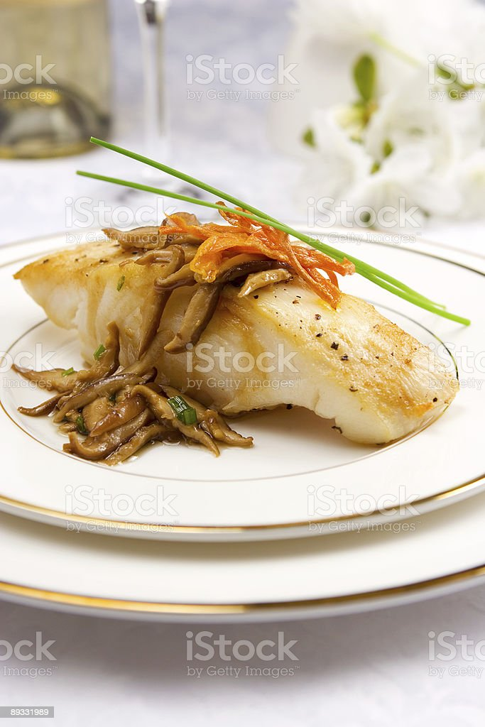Sea bass with mushrooms royalty-free stock photo