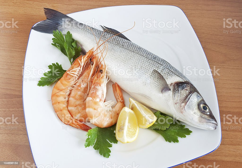 sea bass with parsley and prawns royalty-free stock photo