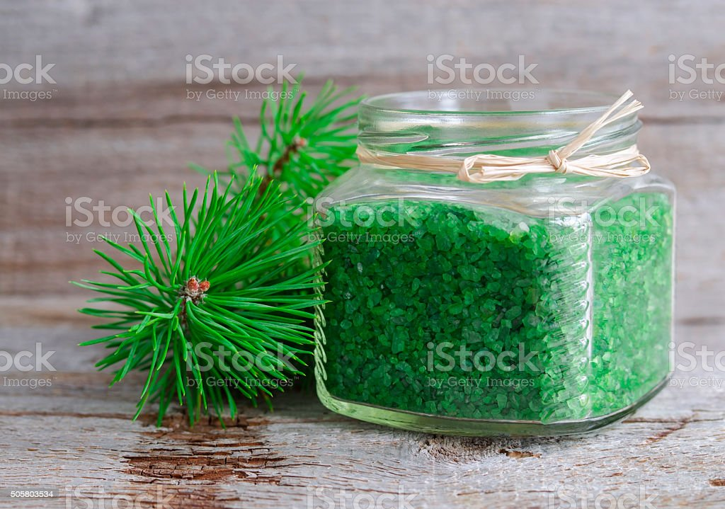 Sea bath salt with pine extract in a glass jar stock photo