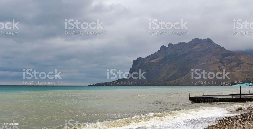 Sea bay and mountain massif Kara-Dag in stormy weather stock photo
