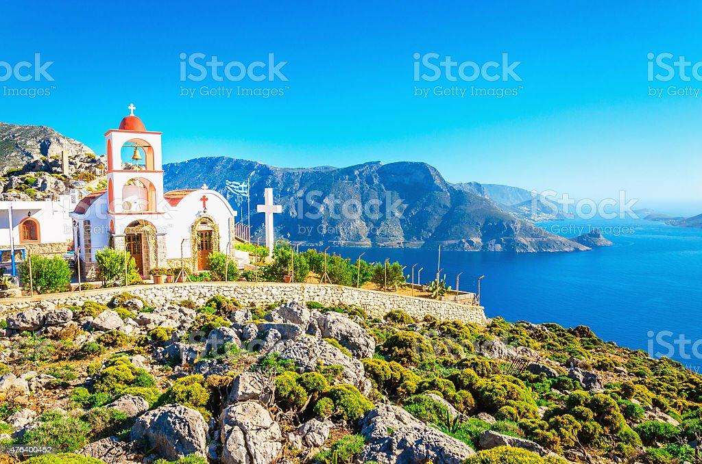 Sea bay on Greek Island with white church stock photo
