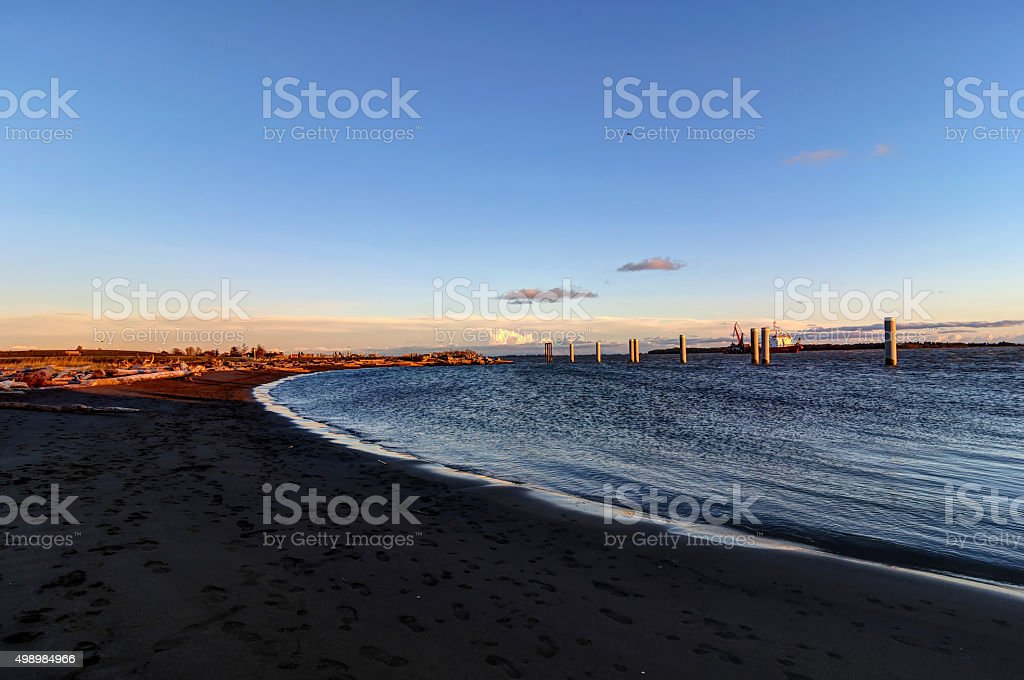 sea beach at sunset stock photo
