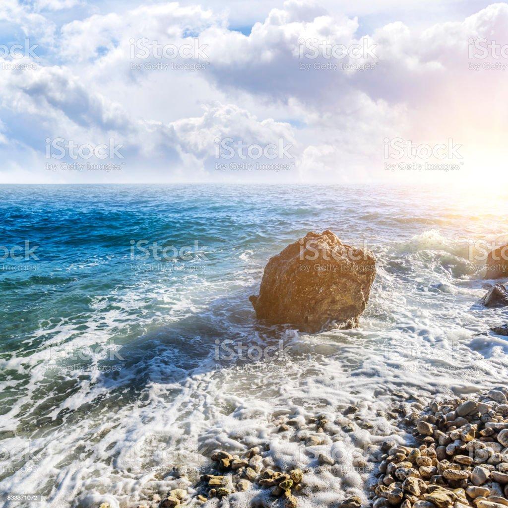 Sea beach. Sea waves crashing against the rocks on the coast stock photo