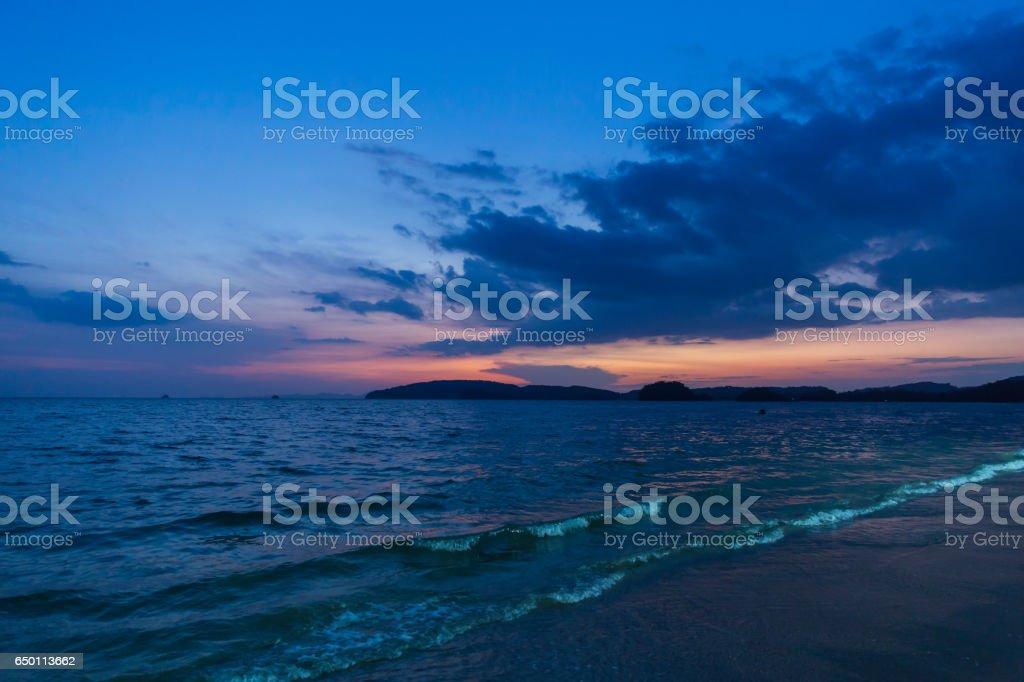 sea beach when sunset dusk blue dark sky. stock photo