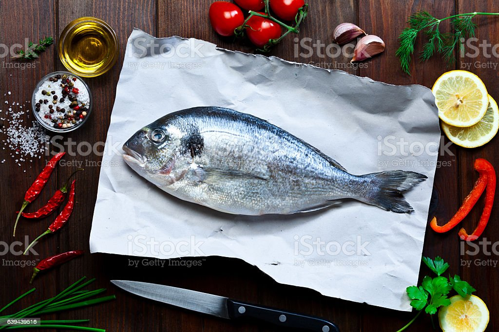 Sea bream and ingredients for cooking and seasoning stock photo