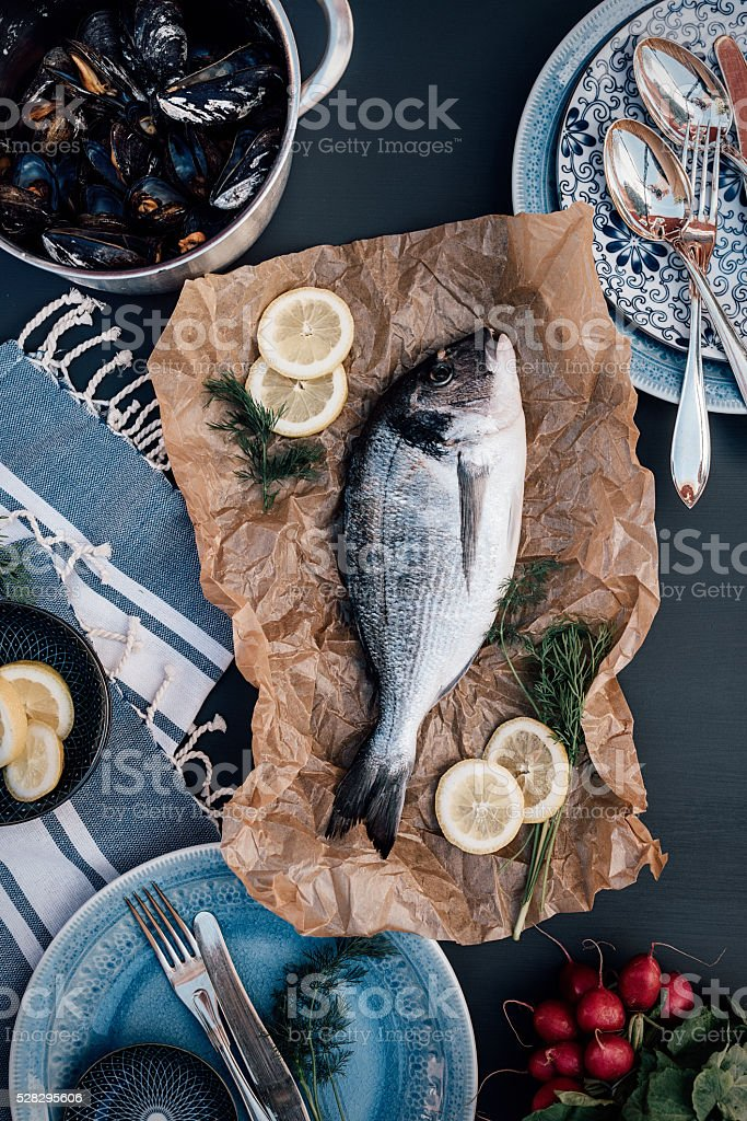 Sea bream fish food arrangement from above stock photo