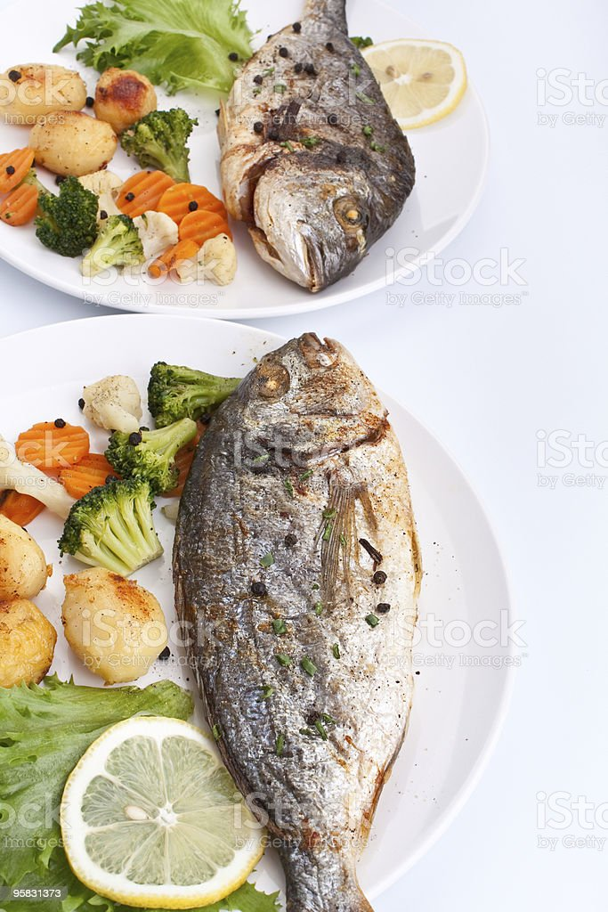 Sea Bream fish with vegetables royalty-free stock photo