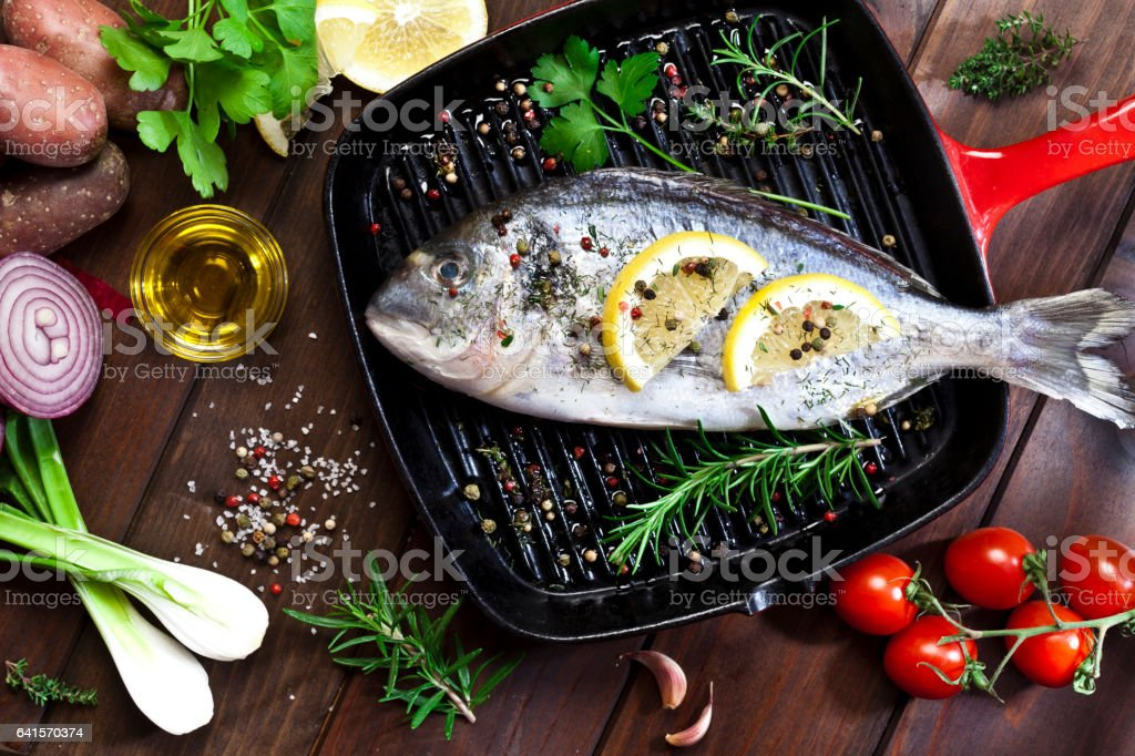 Sea bream in a cooking pan stock photo