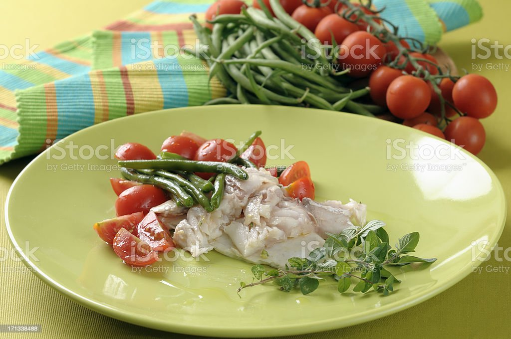 Sea bream salad with green beans and tomatoes royalty-free stock photo