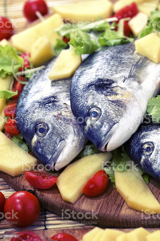 Sea bream with potatoes and tomatoes royalty-free stock photo