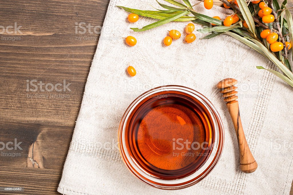 Sea buckthorn oil at right side stock photo