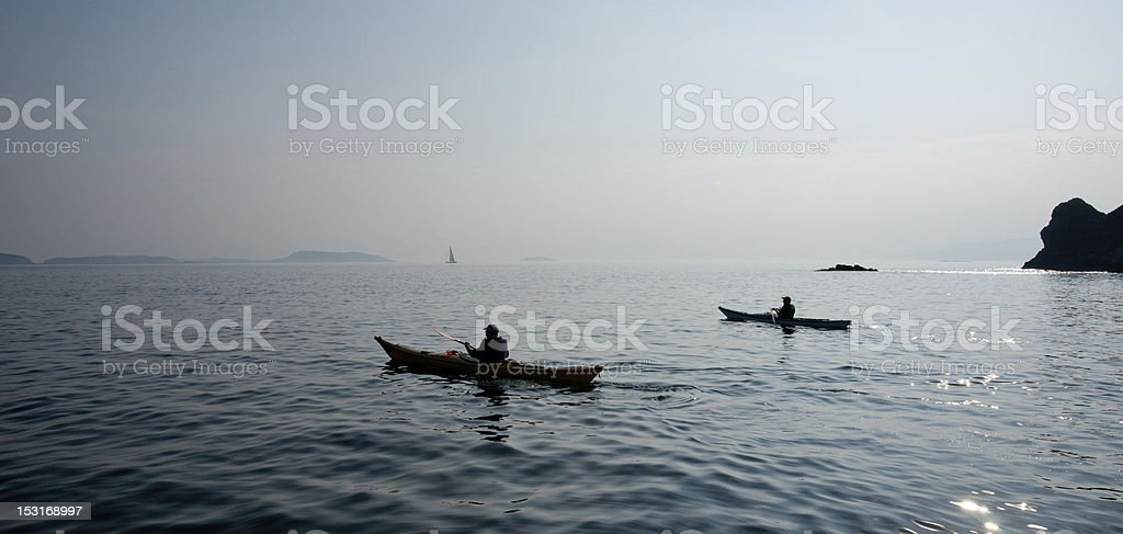 Sea canoeists set off on a bright April day royalty-free stock photo
