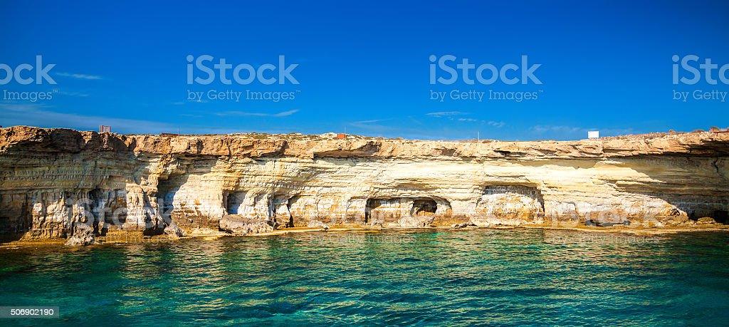Sea caves at Cape Greco stock photo