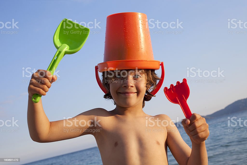 Sea. Child at the beach with shovels and bucket. royalty-free stock photo