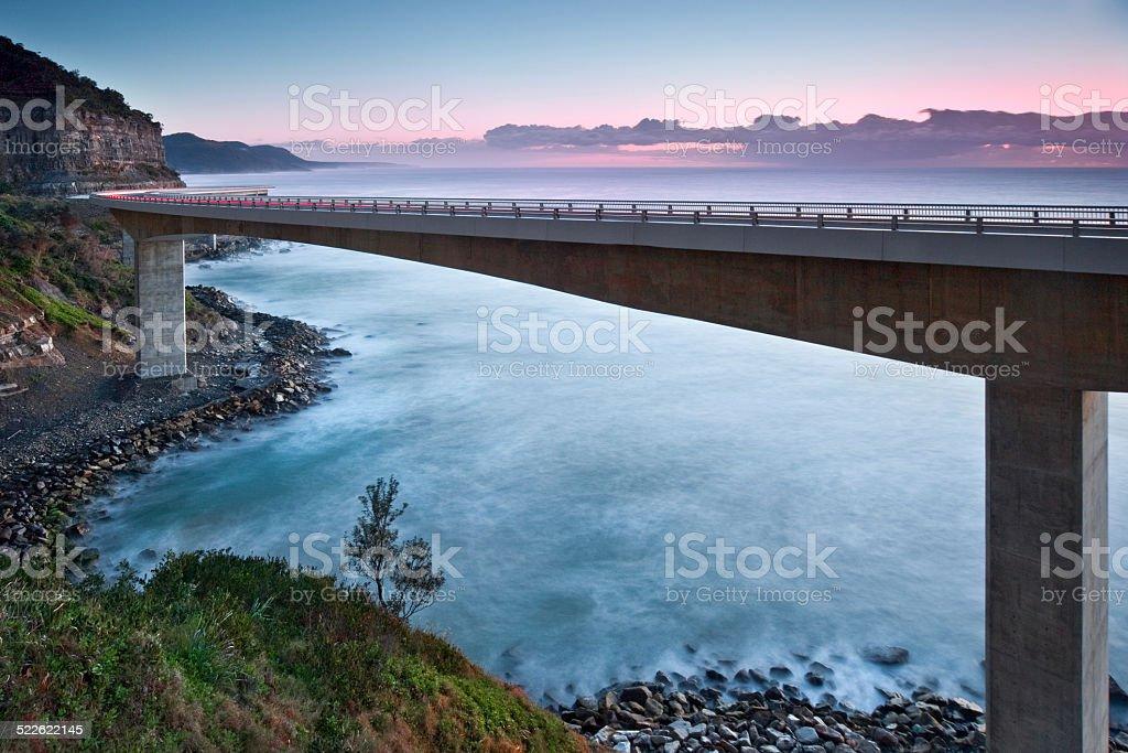 Sea Cliff Bridge at sunrise stock photo
