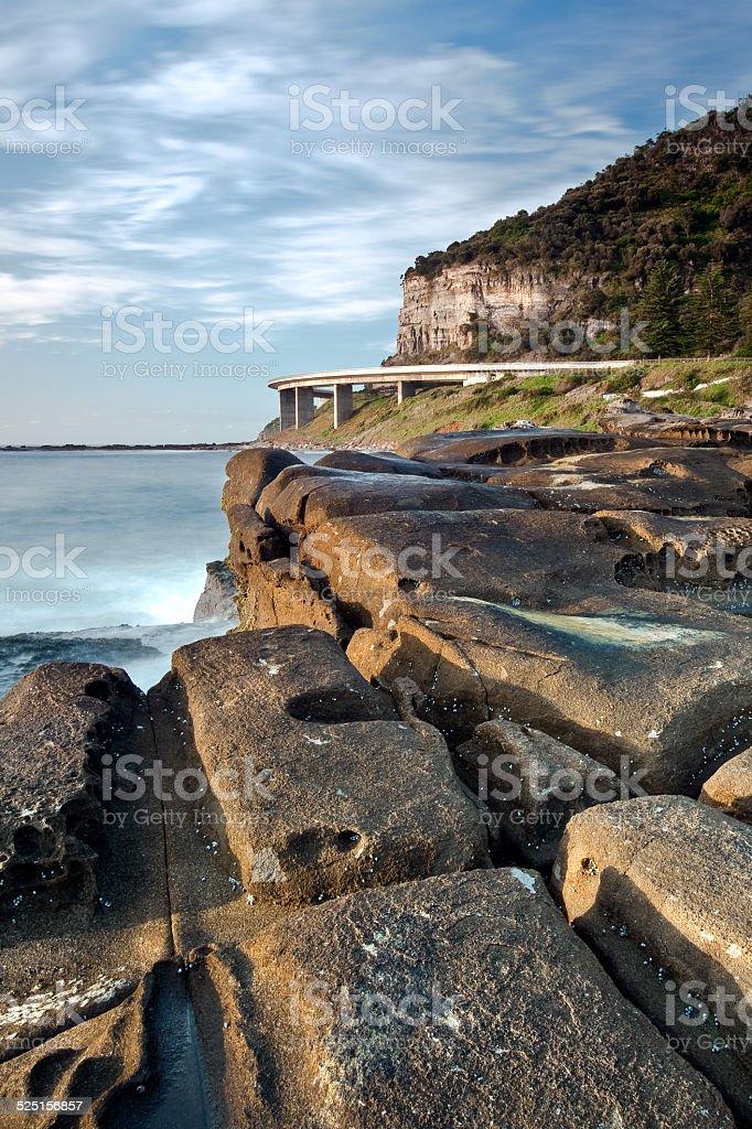 sea cliff bridge from rock platform stock photo