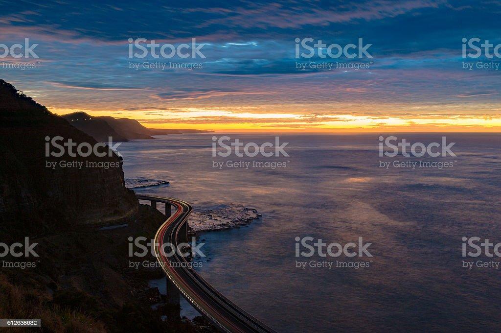 Sea Cliff Bridge on sunrise with moving traffic stock photo