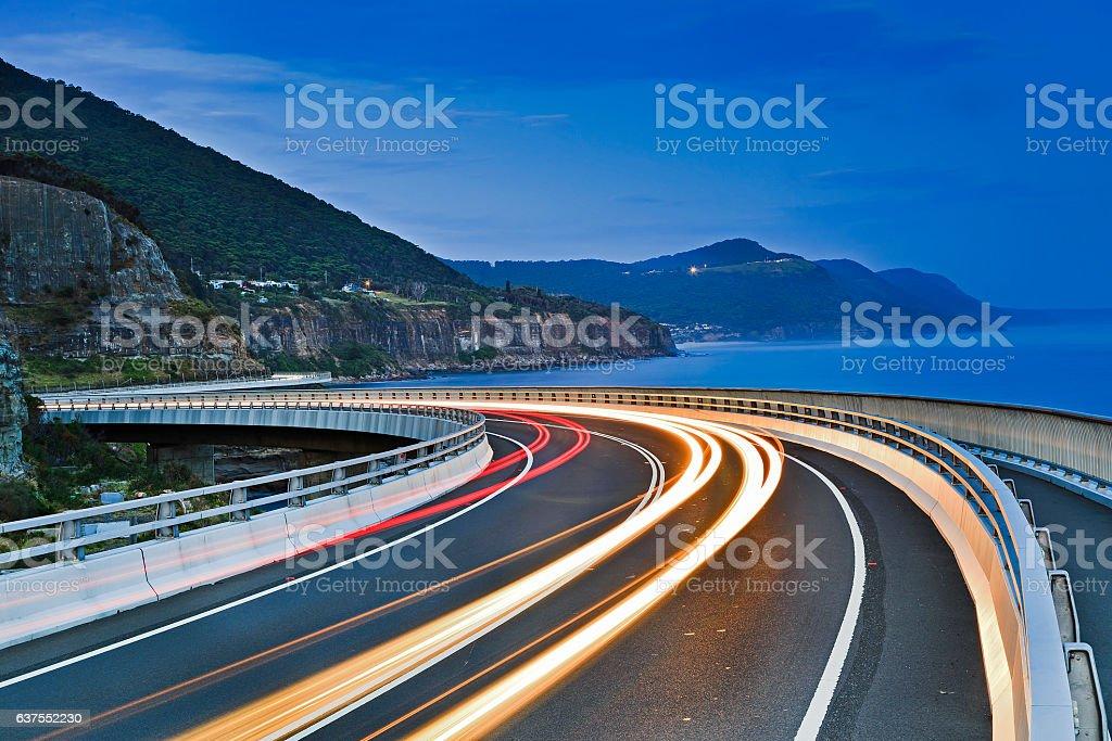 Sea Cliff Bridge Road Bends Lighs Dark stock photo