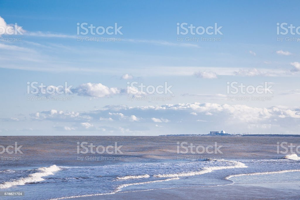 sea clouds with distant nuclear power station Walberswick Suffolk England stock photo