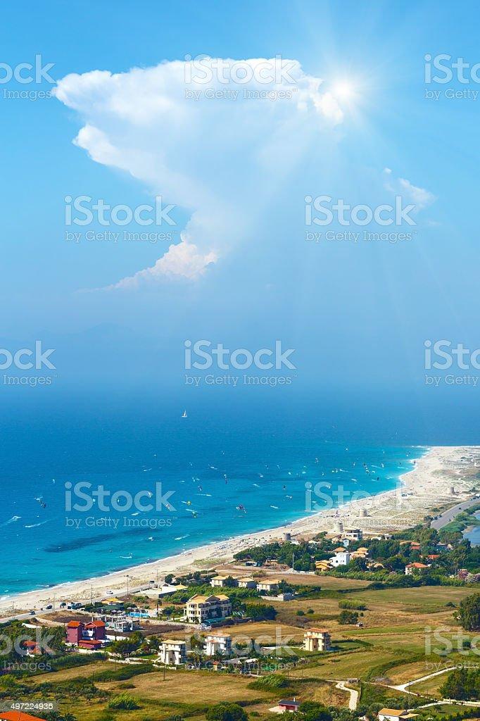 Sea coast and kiteboarders stock photo