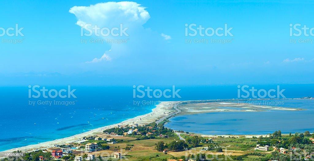 Sea coast panorama and kiteboarders. stock photo