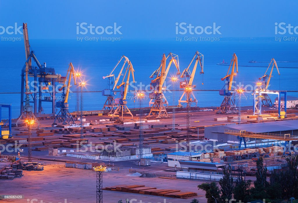 Sea commercial port at night in Mariupol, Ukraine. Industrial landscape stock photo