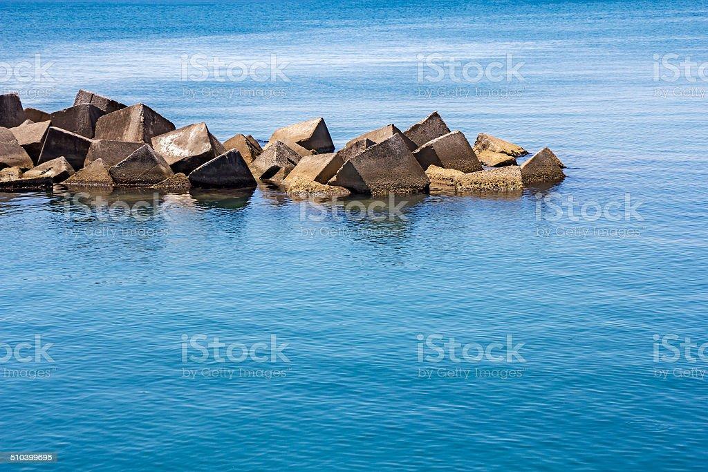 Sea concrete block dam stock photo