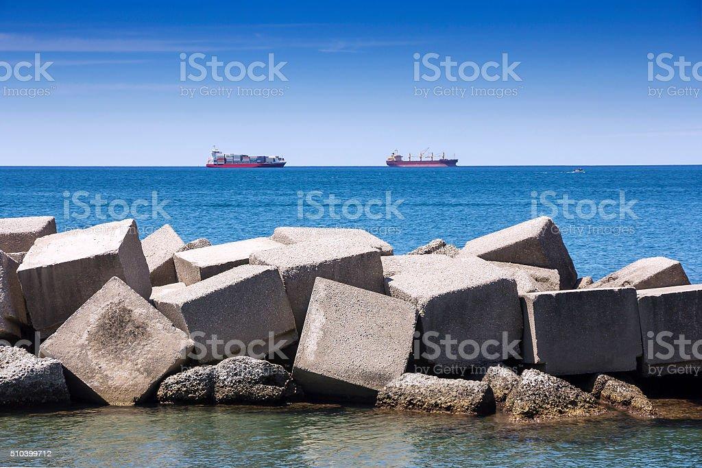 Sea concrete dam stock photo