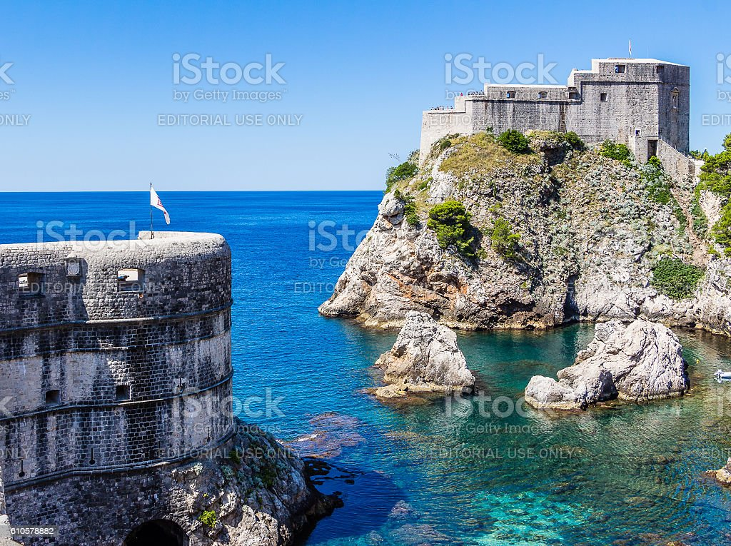 Sea cove, city walls and Fort Lovrijenac in Dubrovnik, Croatia stock photo