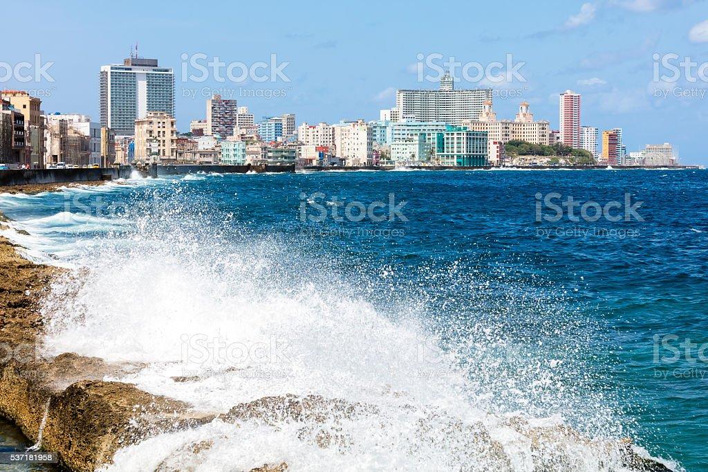 Sea crashing against the rocks alongside the Malecon, Havana, Cuba stock photo