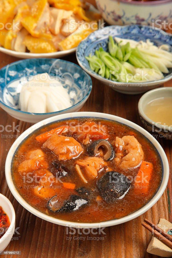 Sea cucumber stewed pork leg stock photo
