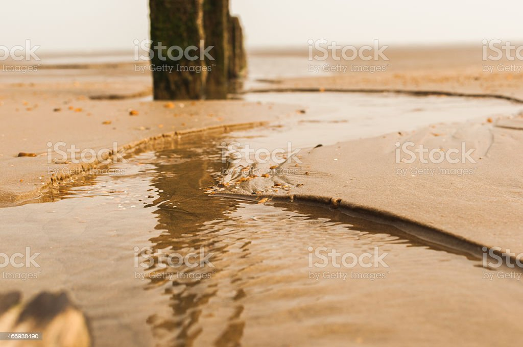 Sea defence low tide stock photo