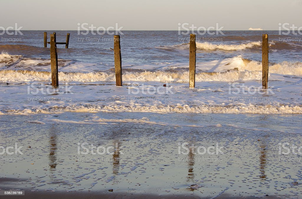 Sea defence posts, Happisburgh, Norfolk stock photo
