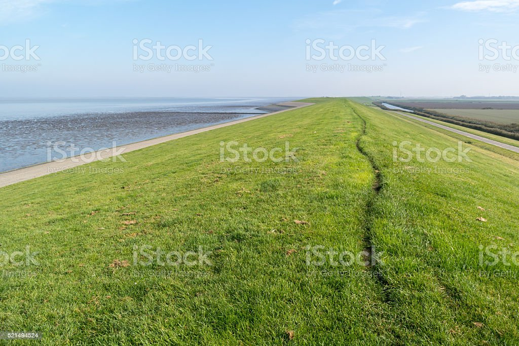 Sea dike between Frisian polders and North Sea, Netherlands stock photo