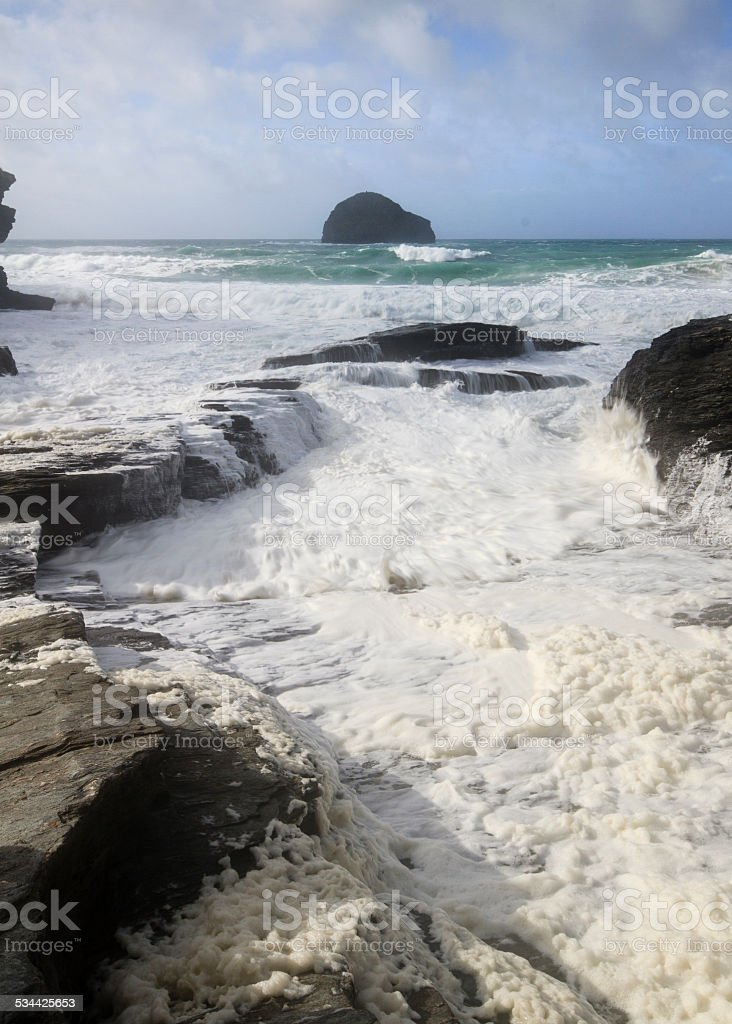 Sea foam at Trebarwith strand stock photo