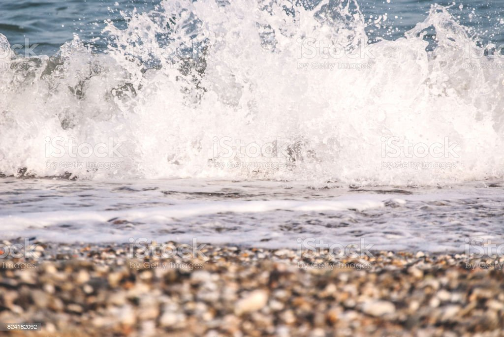 Sea Foam Of The Waves Crushing Into The Shore stock photo