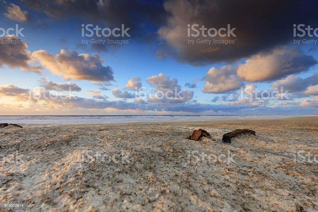 sea foam on the beach stock photo