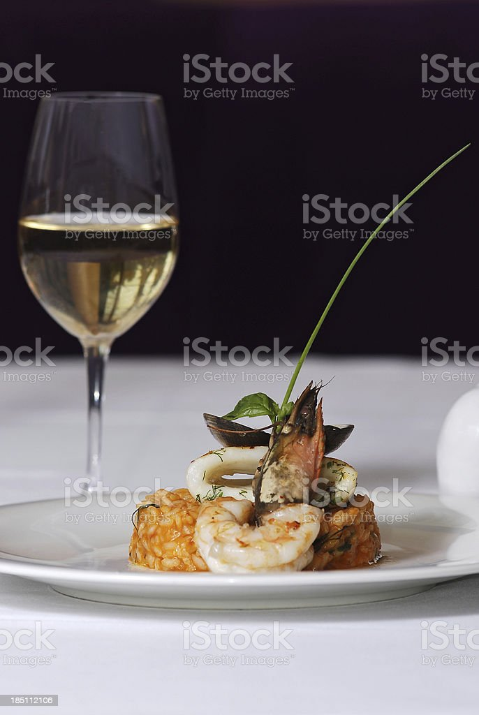 Sea food dish and glass of white wine royalty-free stock photo