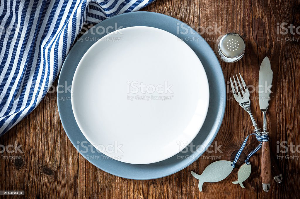 Sea food place setting on wooden table with copy space stock photo