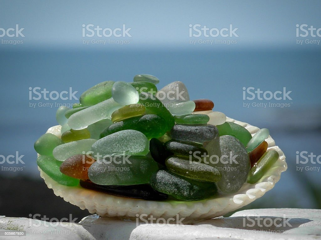 Sea glass pearls in a shell stock photo