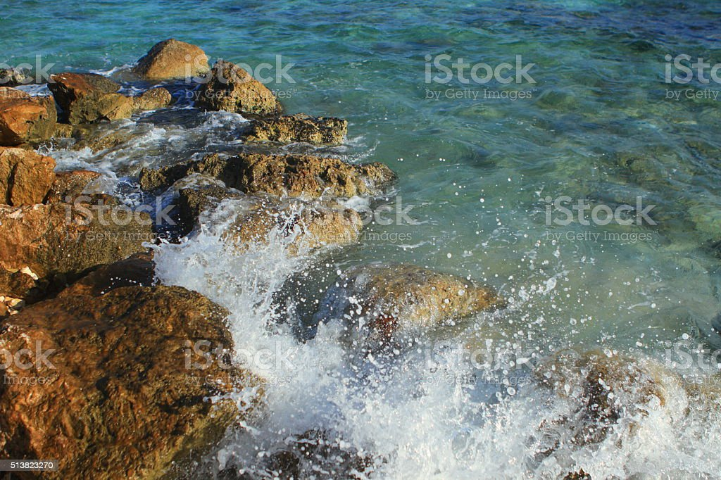 Sea Hitting Rocks at tthe Beach in Fast Shutter Speed stock photo