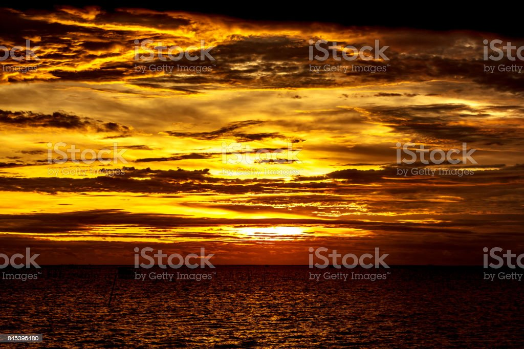 orange sea sun with in horizon and red sky