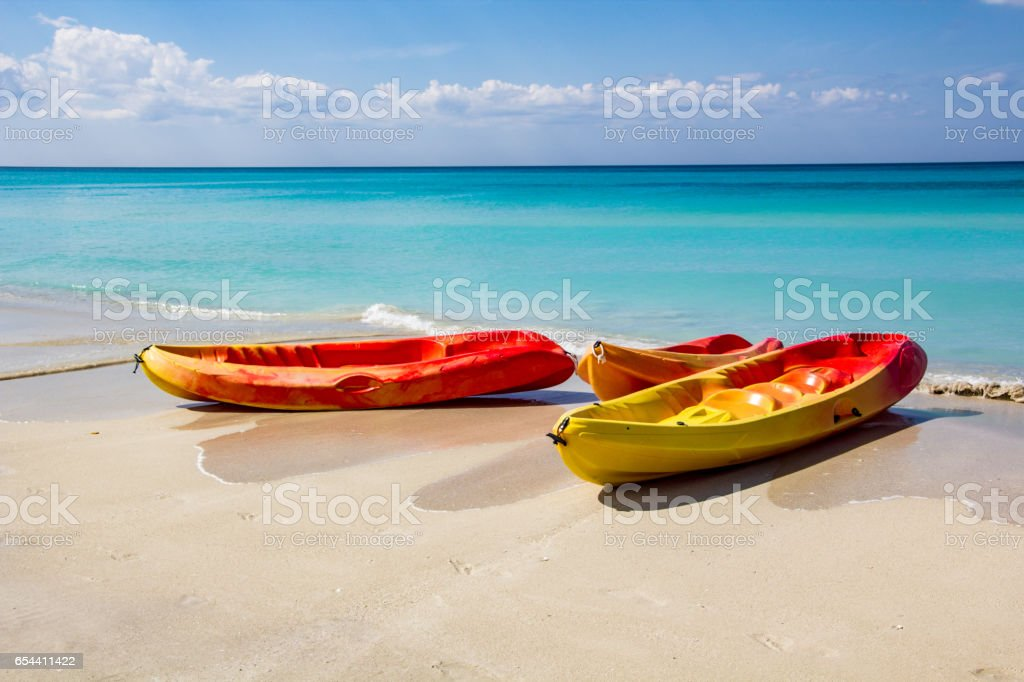 Sea kayaking, canoe, on a tourist resort in Varadero, Cuba. White sand and blue water. stock photo