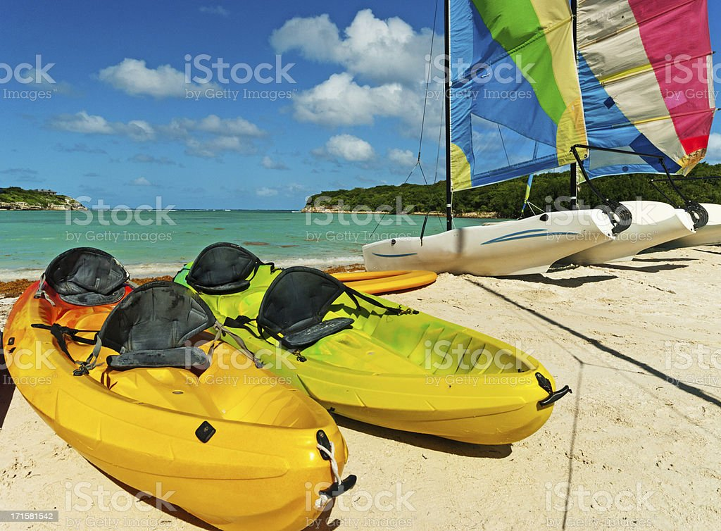 Sea Kayaks and sailing boats in Antigua stock photo