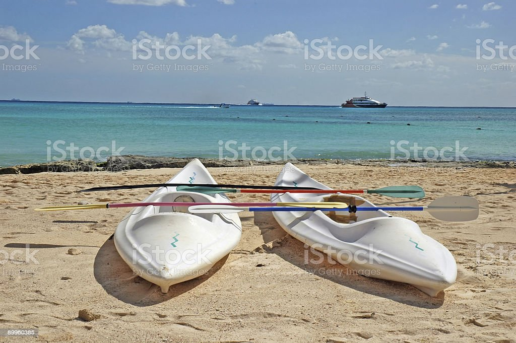 Sea kayaks on the beach closeup stock photo