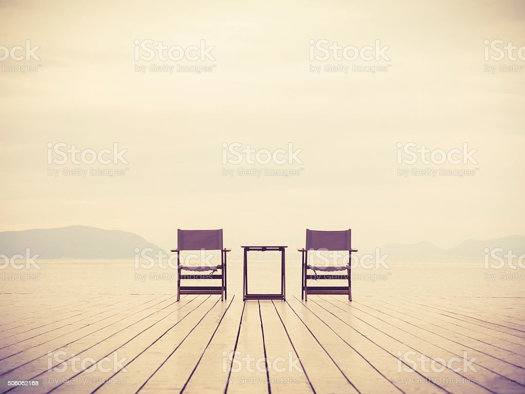 Sea Landscape with two chairs Love concept background stock photo