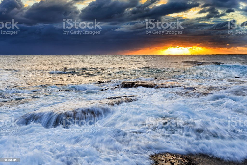 Sea Maroubra Surf over rocks stock photo