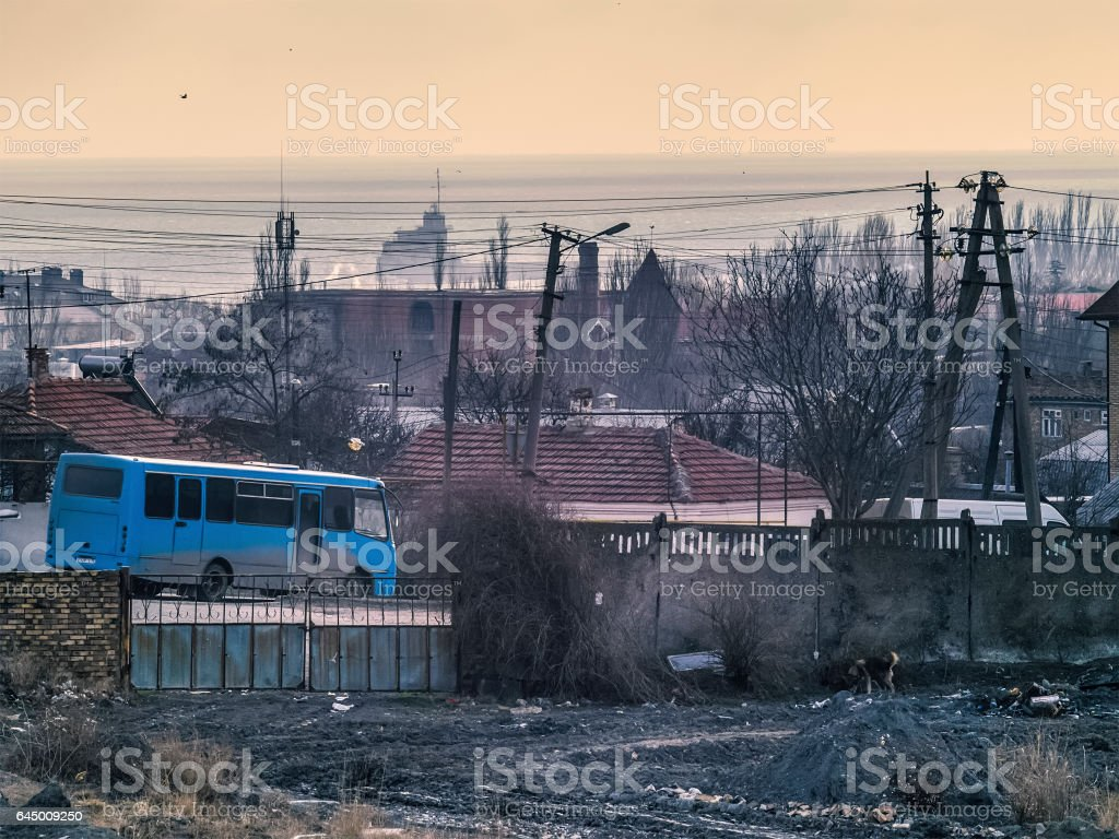 Sea, morning, the industry and the blue bus stock photo