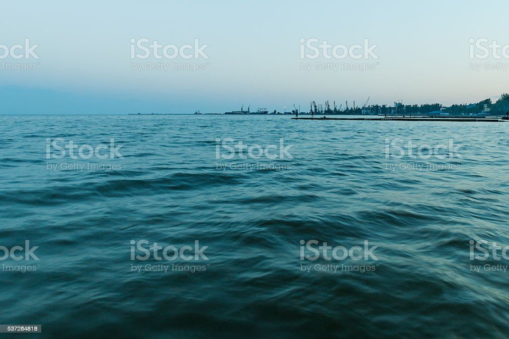 Sea of Azov. Mariupol sea trading port on the horizon stock photo