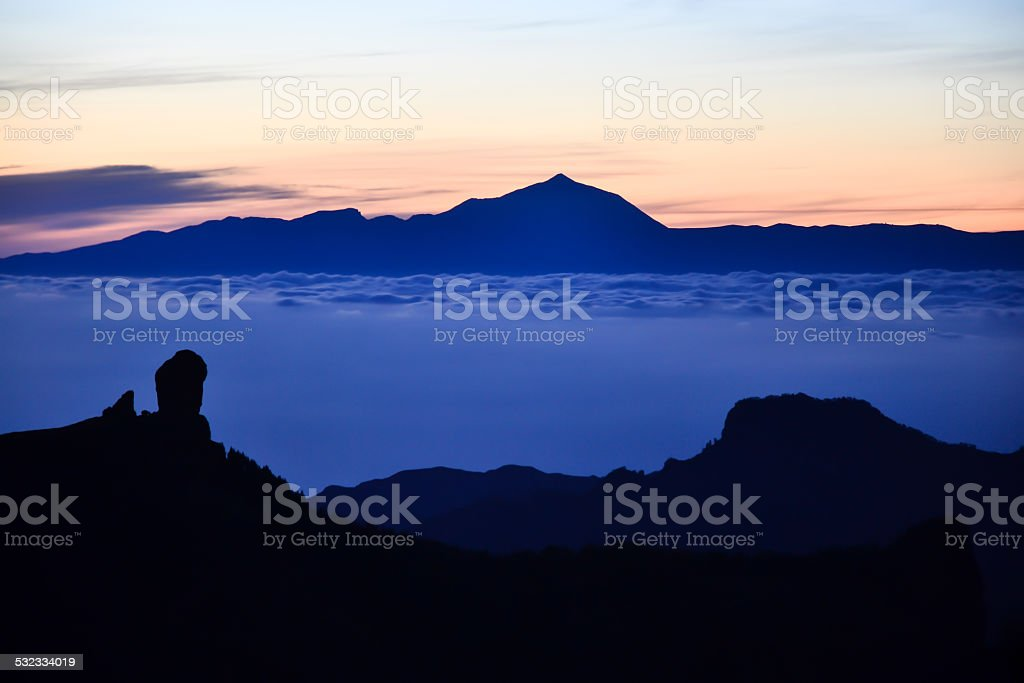 Sea of clouds between Roque Nublo & Teide stock photo